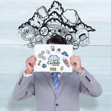 Composite image of businessman holding blank sign in front of his head Royalty Free Stock Images