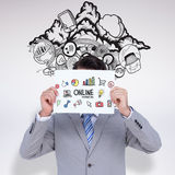 Composite image of businessman holding blank sign in front of his head Royalty Free Stock Photos