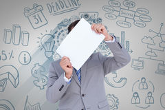 Composite image of businessman holding blank sign in front of his head Stock Image