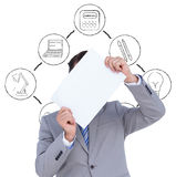 Composite image of businessman holding blank sign in front of his head Stock Photos
