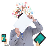 Composite image of businessman holding blank sign in front of his head Royalty Free Stock Photography