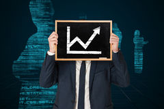Composite image of businessman holding board Royalty Free Stock Images