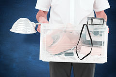 Composite image of businessman holding box of his things Royalty Free Stock Image