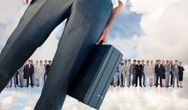 Composite image of businessman holding briefcase Stock Photos