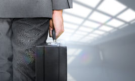 Composite image of businessman holding briefcase Stock Image