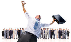 Composite image of businessman holding briefcase and cheering Stock Photo