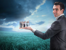 Composite image of businessman holding business team Royalty Free Stock Photos