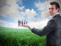 Composite image of businessman holding business team Stock Photography