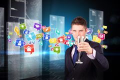 Composite image of businessman holding a champagne glass Stock Photo