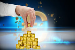 Composite image of businessman holding coins Stock Photo