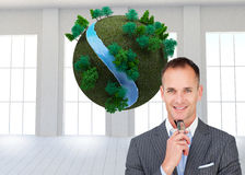 Composite image of businessman holding glasses Royalty Free Stock Photo