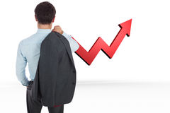 Composite image of businessman holding his jacket Stock Photo