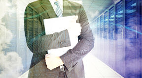 Composite image of businessman holding his laptop tightly Stock Photos