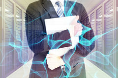 Composite image of businessman holding his laptop tightly Royalty Free Stock Images