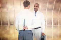 Composite image of businessman holding knife behind his back Royalty Free Stock Images
