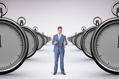 Composite image of businessman holding scales of justice Stock Photography