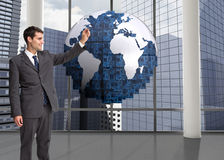 Composite image of businessman holding something up in the air Royalty Free Stock Photography