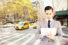 Composite image of businessman holding a tablet computer Royalty Free Stock Photos