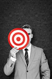 Composite image of businessman holding target Royalty Free Stock Photos