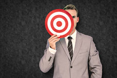 Composite image of businessman holding target Stock Photos