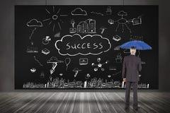 Composite image of businessman holding umbrella Royalty Free Stock Photo