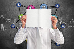 Composite image of businessman holding a white card covering his face Stock Images