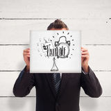 Composite image of businessman holding a white card in front of his face Royalty Free Stock Images