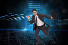 Composite image of businessman in a hurry Royalty Free Stock Photo