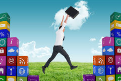 Composite image of businessman leaping with his briefcase Stock Photography