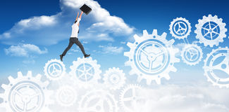 Composite image of businessman leaping with his briefcase. Businessman leaping with his briefcase against bright blue sky with clouds Royalty Free Stock Photography