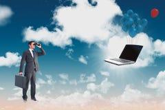 Composite image of businessman looking through binoculars Stock Photos