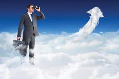 Composite image of businessman looking through binoculars Stock Image