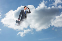 Composite image of businessman looking through binoculars Stock Images
