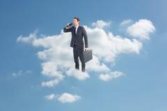Composite image of businessman looking through binoculars Royalty Free Stock Image