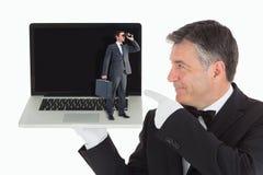 Composite image of businessman looking through binoculars Stock Photography