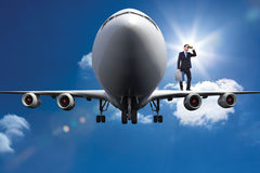 Composite image of businessman looking through binoculars holding briefcase Royalty Free Stock Images