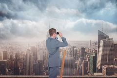Composite image of businessman looking on a ladder Royalty Free Stock Photo