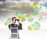 Composite image of businessman looking on a ladder Royalty Free Stock Images