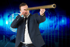 Composite image of businessman looking through telescope Royalty Free Stock Images