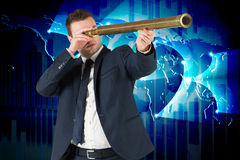 Composite image of businessman looking through telescope Stock Photo