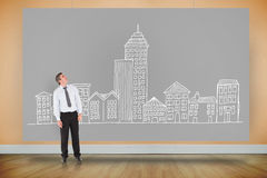 Composite image of businessman looking up Royalty Free Stock Images