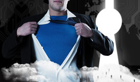 Composite image of businessman opening his shirt superhero style Stock Photos