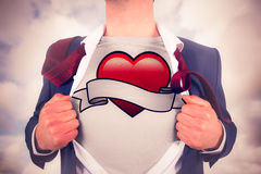 Composite image of businessman opening shirt in superhero style Royalty Free Stock Images
