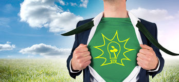 Composite image of businessman opening shirt in superhero style Stock Photos