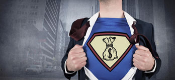 Composite image of businessman opening shirt in superhero style Royalty Free Stock Photo