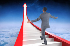 Composite image of businessman performing a balancing act Royalty Free Stock Photos