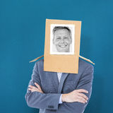 Composite image of businessman with photo box on head Royalty Free Stock Photo