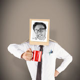Composite image of businessman with photo box on head Stock Images