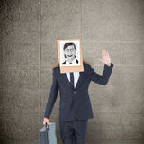 Composite image of businessman with photo box on head Royalty Free Stock Images