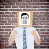 Composite image of businessman with photo box on head Stock Photo